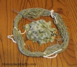 seeds and green spun cotton from 1 ounce fiber/seeds--plus spindle
